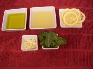 Olive Oil, Lemon Juice, Lemon Wheels, Minced Garlic and Mint Leaves