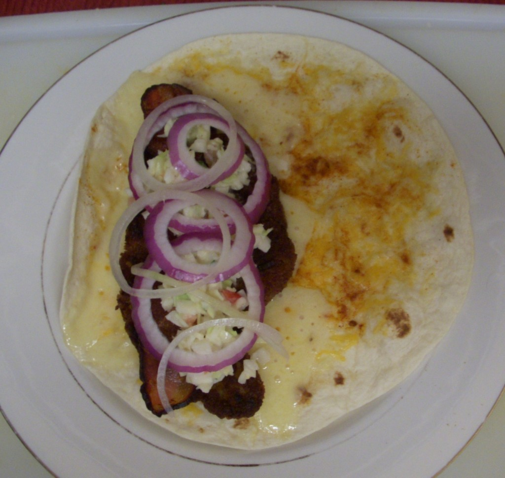 fish taco with pickled onions and sharp cheddar